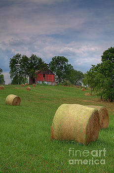 Larry Braun - Hay Bales by a Red Barn