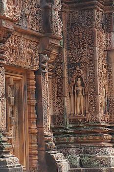 Intricate stone carving on red sandstone doorways and portals by Steve Estvanik