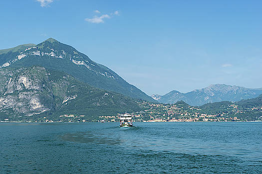Lake Como Gems - a Ferryboat Approaching Charming Menaggio on Lago di Como in Lombardy Italy  by Georgia Mizuleva