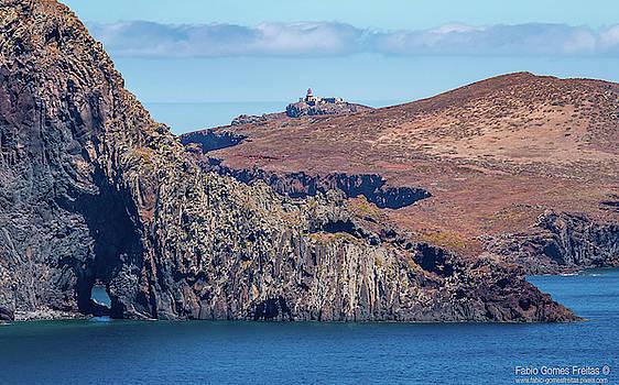 Lighthouse on Cliff by Fabio Gomes Freitas
