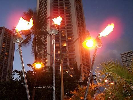 Lighting Tiki Torches Lights at Hula Mound Waikiki by Carolyn Hebert