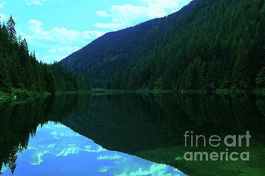 Lingering in a beautiful stillness by Jeff Swan