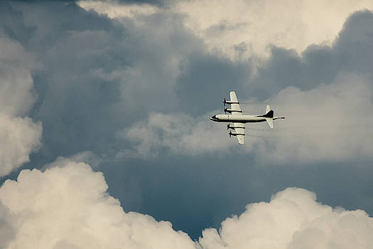 Lockheed P-3C Orion flying through the clouds by Scott Lyons