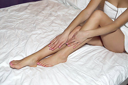 Long Legs Of Girl Sitting In Bed by Elena Saulich
