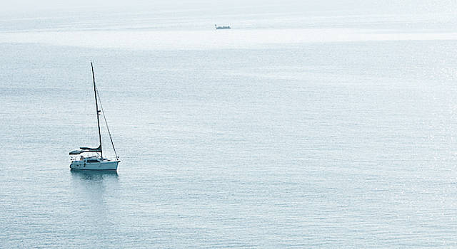 Luxury yacht in the calm ocean by Michalakis Ppalis