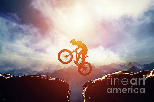 Man jumping with bike between two high mountains by Michal Bednarek