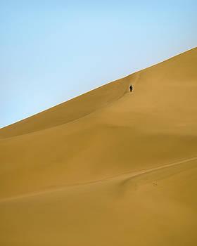 Man on Dunes Dunhuang Gansu China by Adam Rainoff