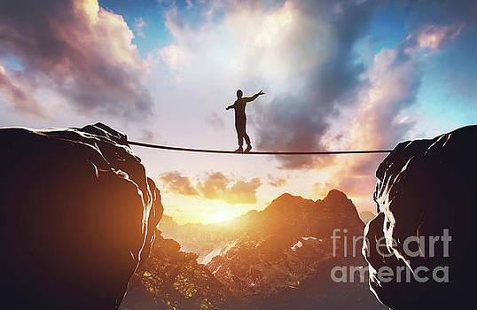 Man walking on rope between two high mountains by Michal Bednarek
