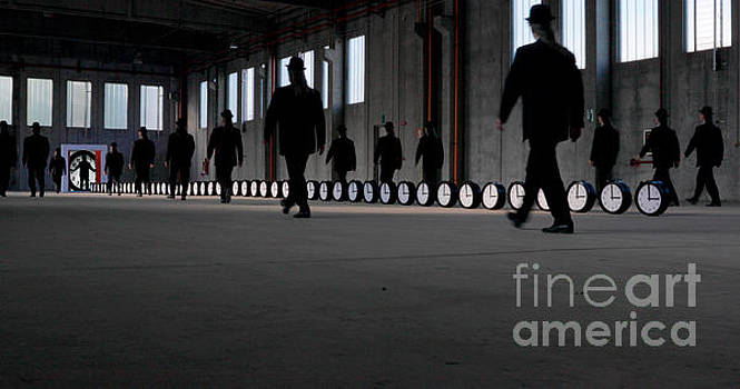Men in factory with clocks by Roberto Agagliate