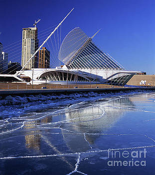Milwaukee Art Museum Reflecting in Ice Floating on the Lake by Wernher Krutein