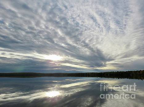 Mirrored clouds by Brenda Ketch