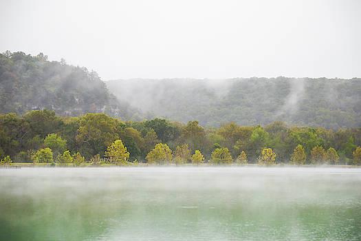 Misty morning at lake by Hyuntae Kim