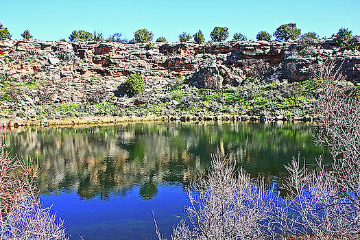 Montezuma's Well AZ water blue sky reflections stone wall 3192019 5253. by David Frederick