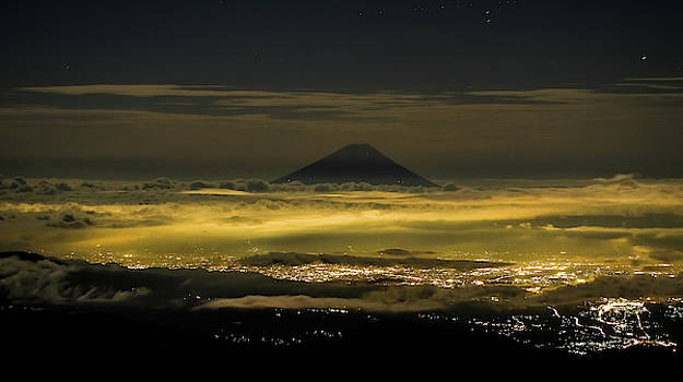 Mt. Fuji above the city lights by Nate Richards