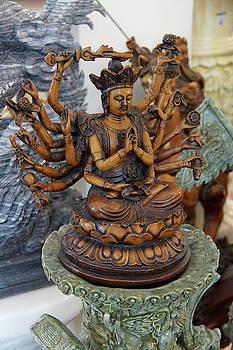 Multi - armed Chinese Buddha statue by Steve Estvanik