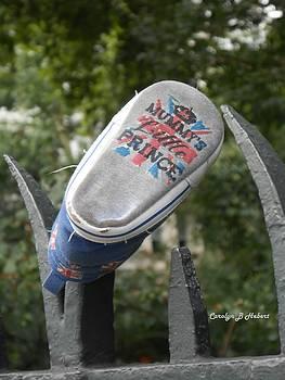 Mummy's Little Prince Shoe On Fence in London by Carolyn Hebert