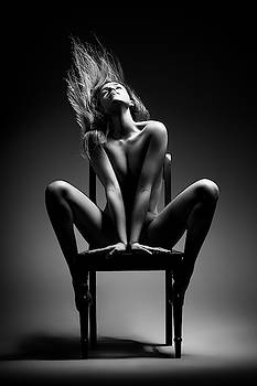 Nude woman sitting on chair by Johan Swanepoel