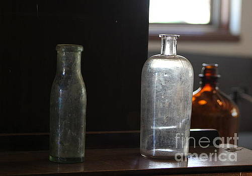 Old Bottles at Fort Stanton New Mexico by Colleen Cornelius