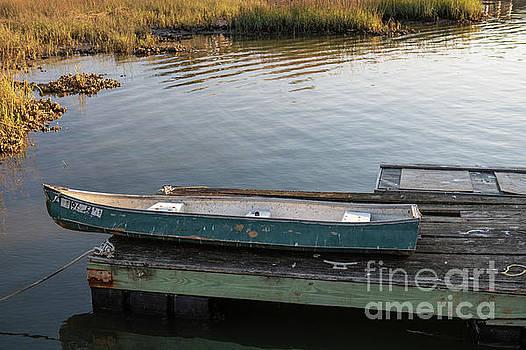 Old Canoe on Dock in Shem Creek by Dale Powell