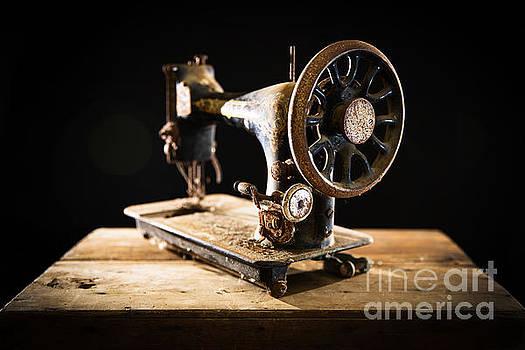 Antique rusty sewing machine by Roberto Agagliate