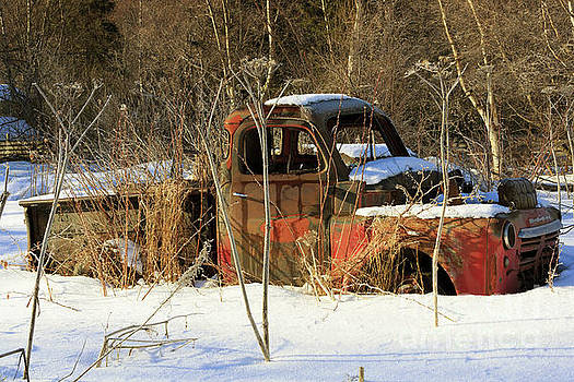 Old truck in winter snow in Hope Alaska by Louise Heusinkveld