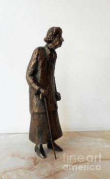 Old woman with a cane and a bag by Nikola Litchkov