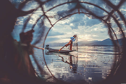 One-Leged Fishermen of Inle Lake by Laurent Derossi