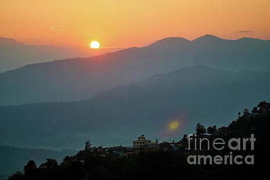 Orange sunrise above mountain in valley Himalayas mountains by Raimond Klavins