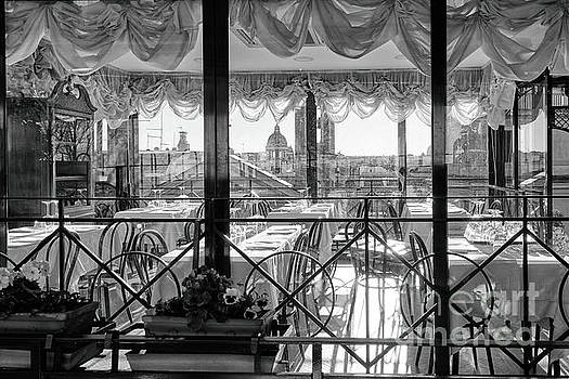 Patio Dining Room With City View by George Oze