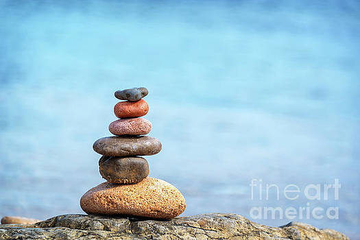Pile of beach pebbles by Delphimages Photo Creations
