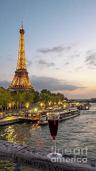 Portrait View of the Eiffel Tower At Night with Wine Glass in the Foreground by PorqueNo Studios
