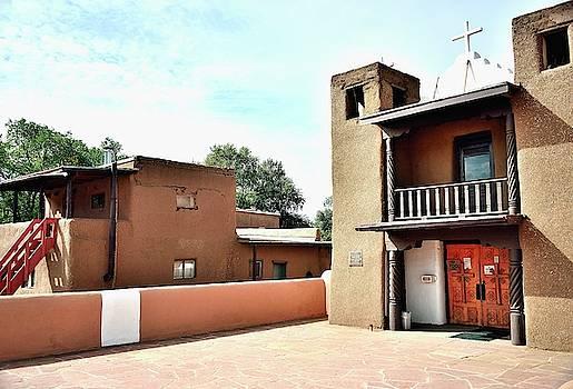 Pueblo Church yard by Gerald Blaine