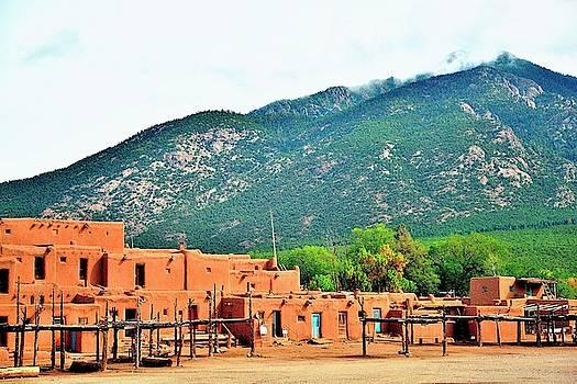 Pueblo Indian quarters by Gerald Blaine