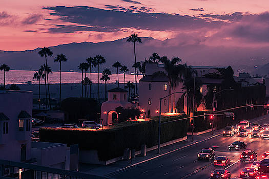 Purple sunset in Santa Monica with palms and traffic on freeway by Natalia Macheda