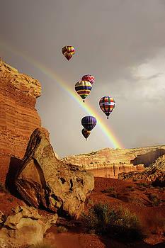 Rainbow and brief dramatic sunshine by Steve Estvanik