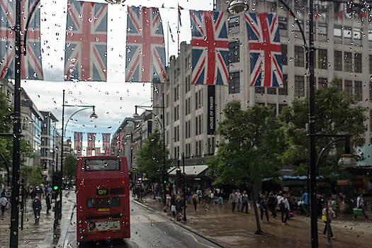 Rainy London - Oxford Street Red Double Decker Bus and Union Jacks by Georgia Mizuleva