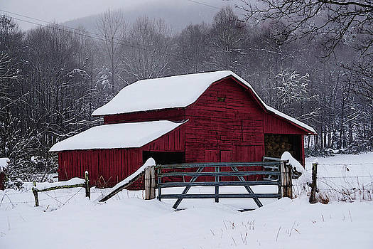 Red barn in the snow by Seth Solesbee