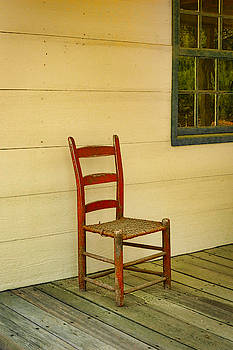 Red Chair On Porch by Robert Meyerson
