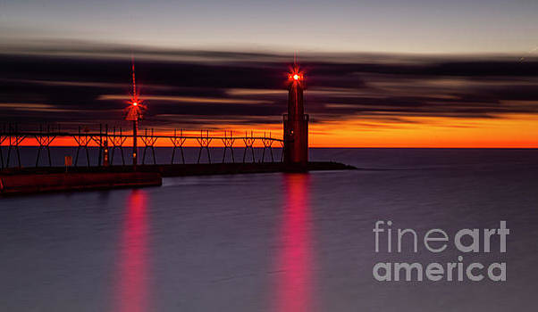 Red reflections with the orange sky by Randy Kostichka