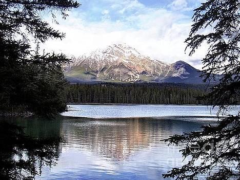 Campwillowlake - Reflection of Pyramid Mountain on Pyramid Lake in Jasper Canada