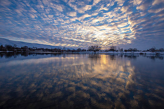 Reflections of clouds by Lynn Hopwood