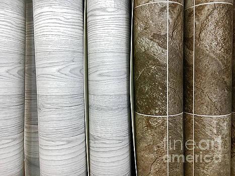 Rolls of vinyl flooring by Tom Gowanlock