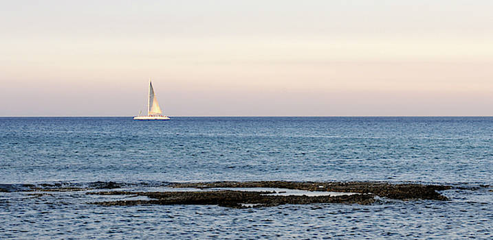 Sailing boat in the Calm Ocean by Michalakis Ppalis