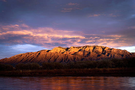 Sandia Mountains and the Rio Grande sunset by Howard Holley