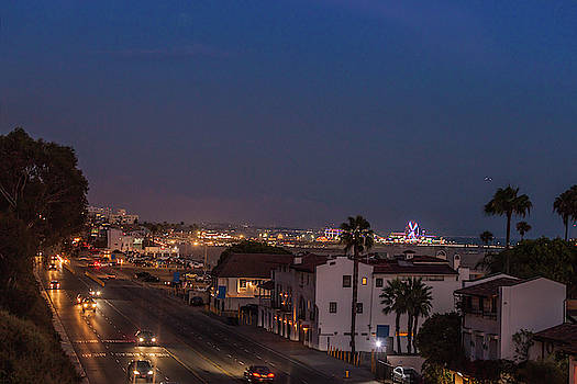 Santa Monica pier and Pacific freeway in dusk by Natalia Macheda
