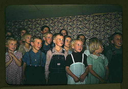 School children singing by MotionAge Designs