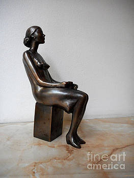 Sculpture of a girl with a cup of coffee by Nikola Litchkov