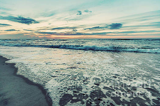 Sea at sunset. Sun reflection in waves. Vintage tone by Michal Bednarek