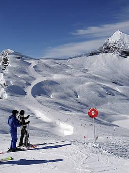 Skiers descend open slopes by Steve Estvanik