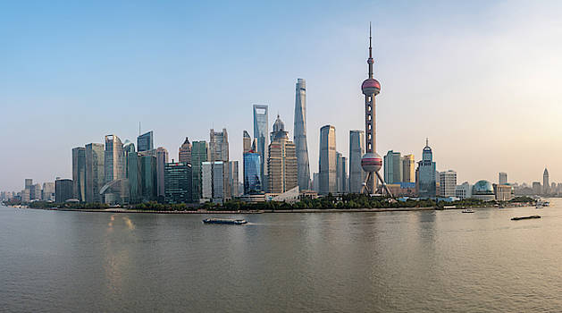 Skyline of the city of Shanghai at sunset by Steven Heap